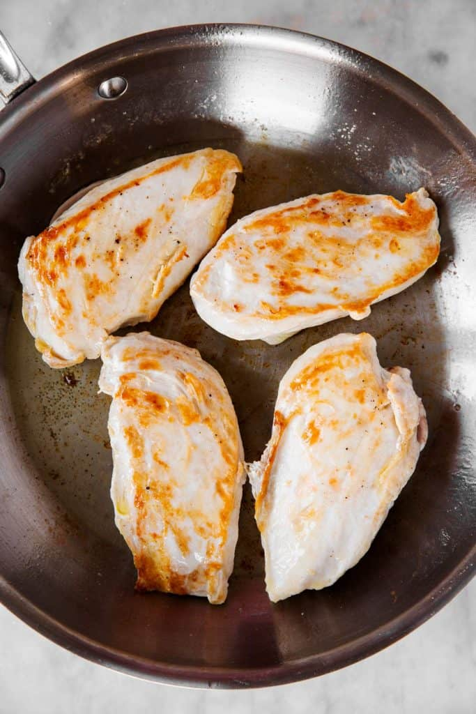 seared chicken breast in skillet