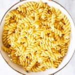 cooked pasta in white colander