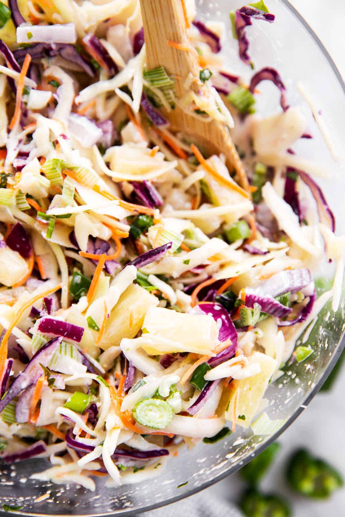 close up photo of pineapple coleslaw in glass bowl