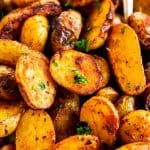 close up view of roasted baby potatoes in serving bowl