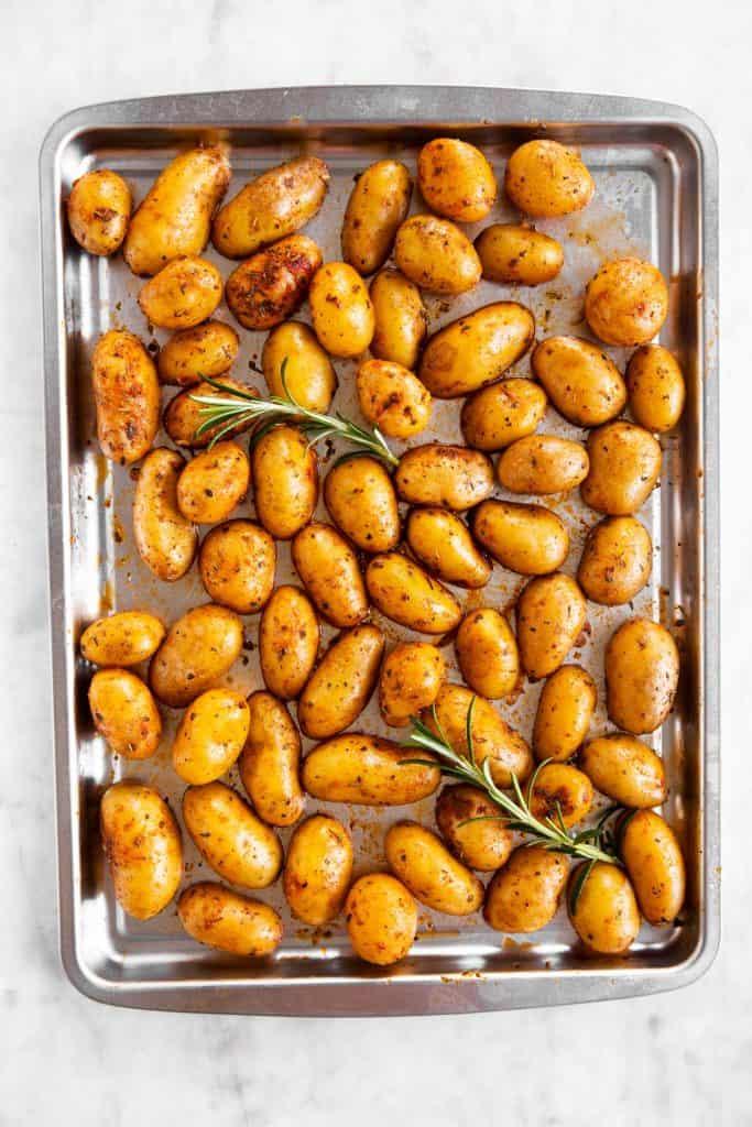 raw baby potatoes on silver sheet pan