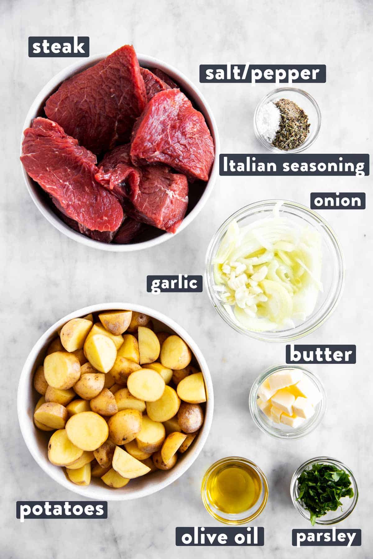 ingredients for steak and potato foil packets with text labels