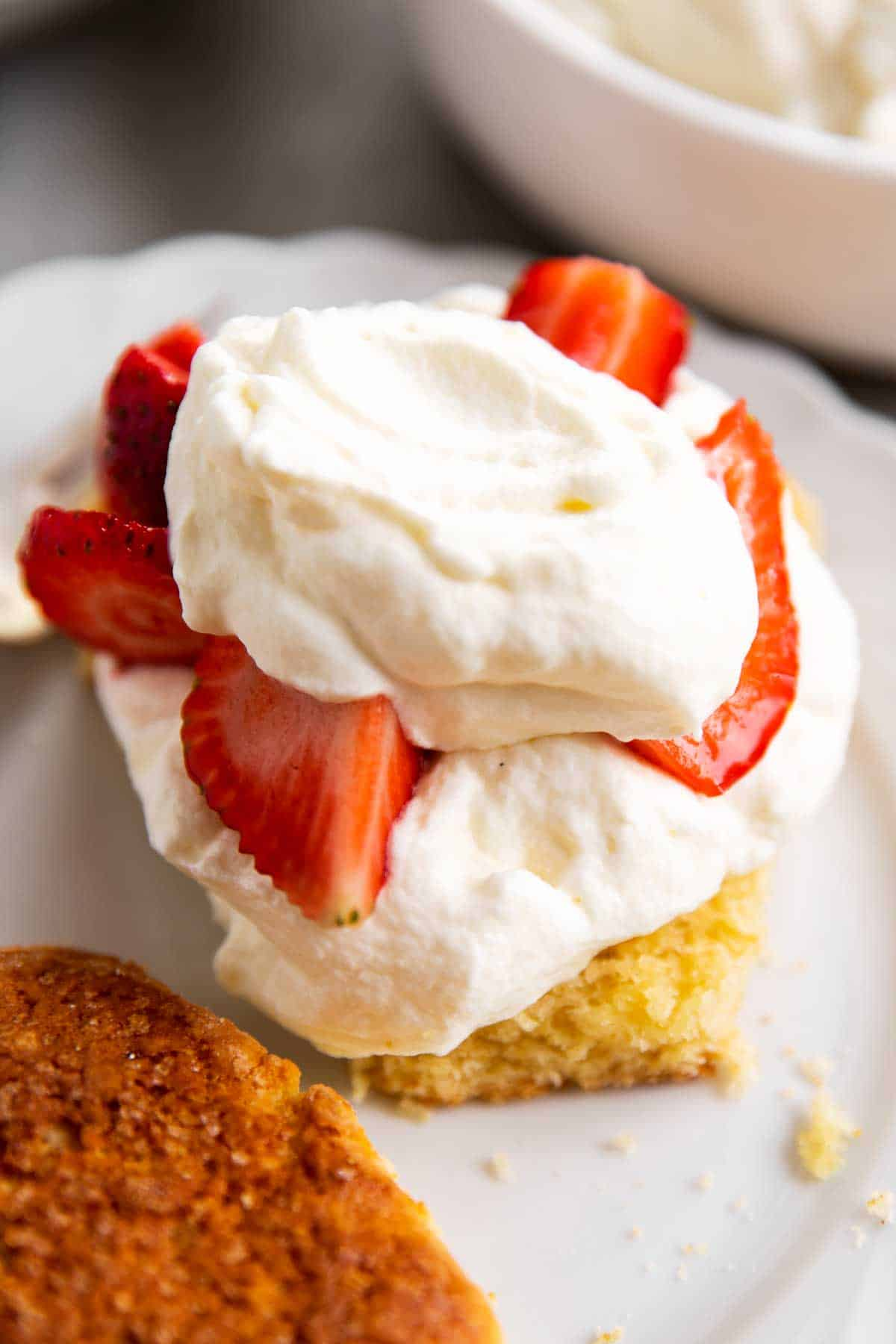 split shortcake topped with whipped cream and strawberries