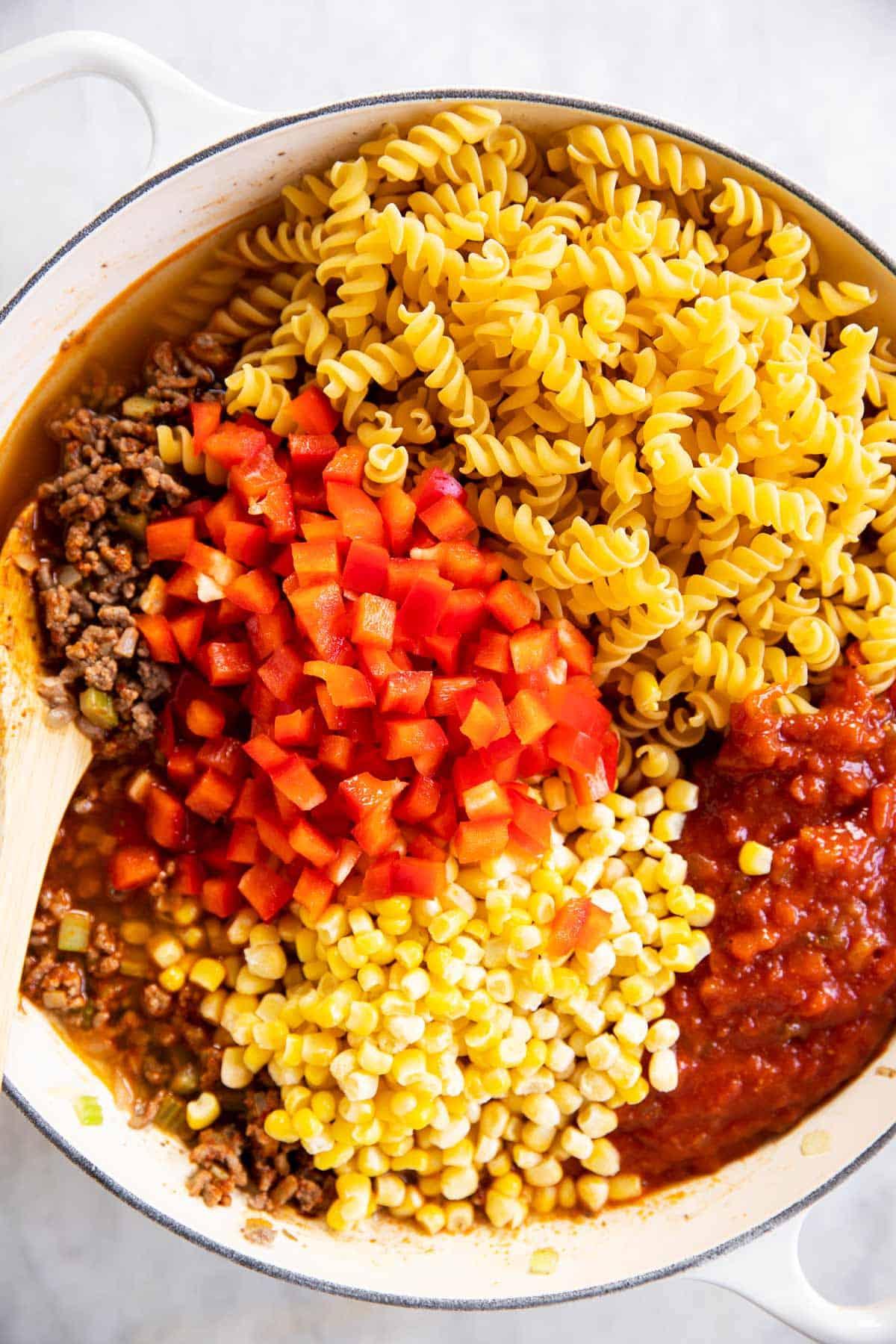 ingredients for taco pasta in white skillet
