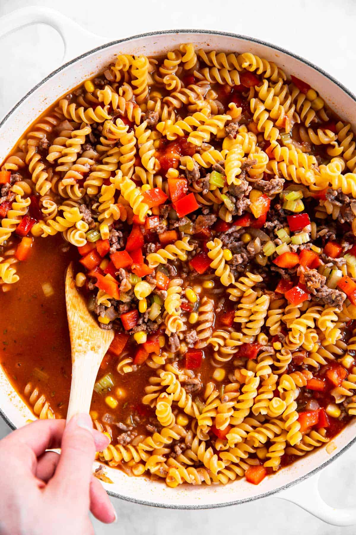 uncooked taco pasta in white skillet