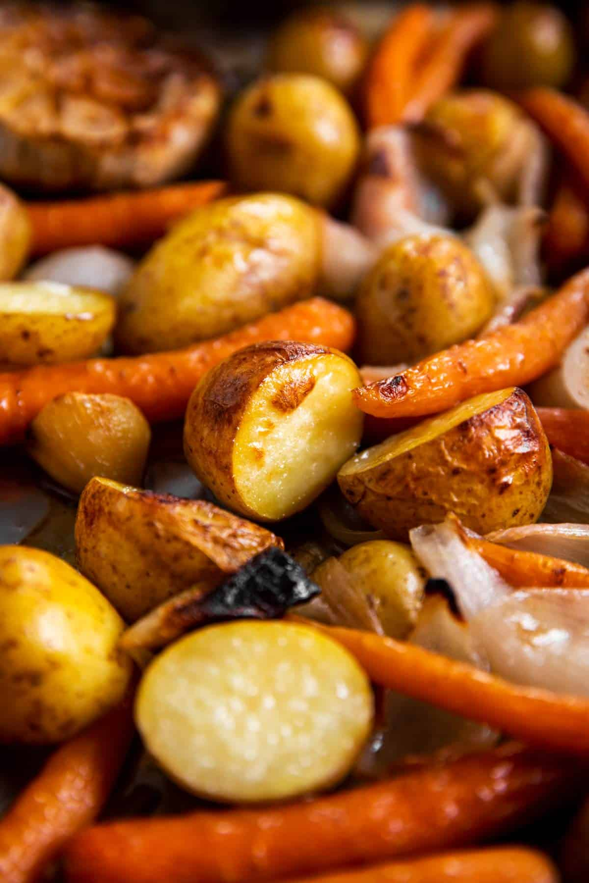 close up photo of roasted carrots and potatoes