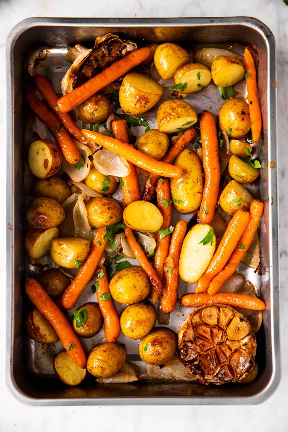 roasted carrots and potatoes in roasting pan