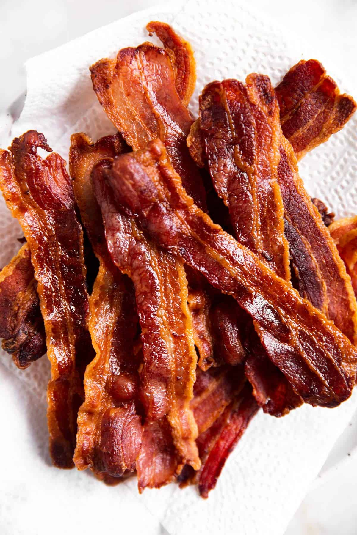 overhead view of air fried bacon on paper towel lined plate