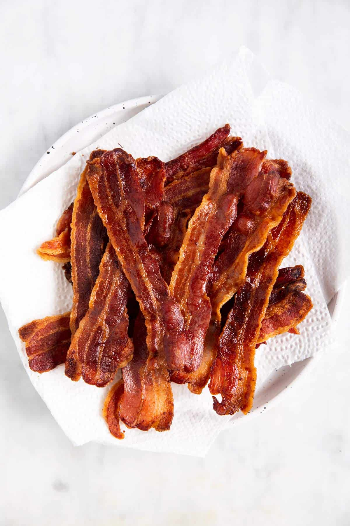 cooked bacon on paper towel lined plate