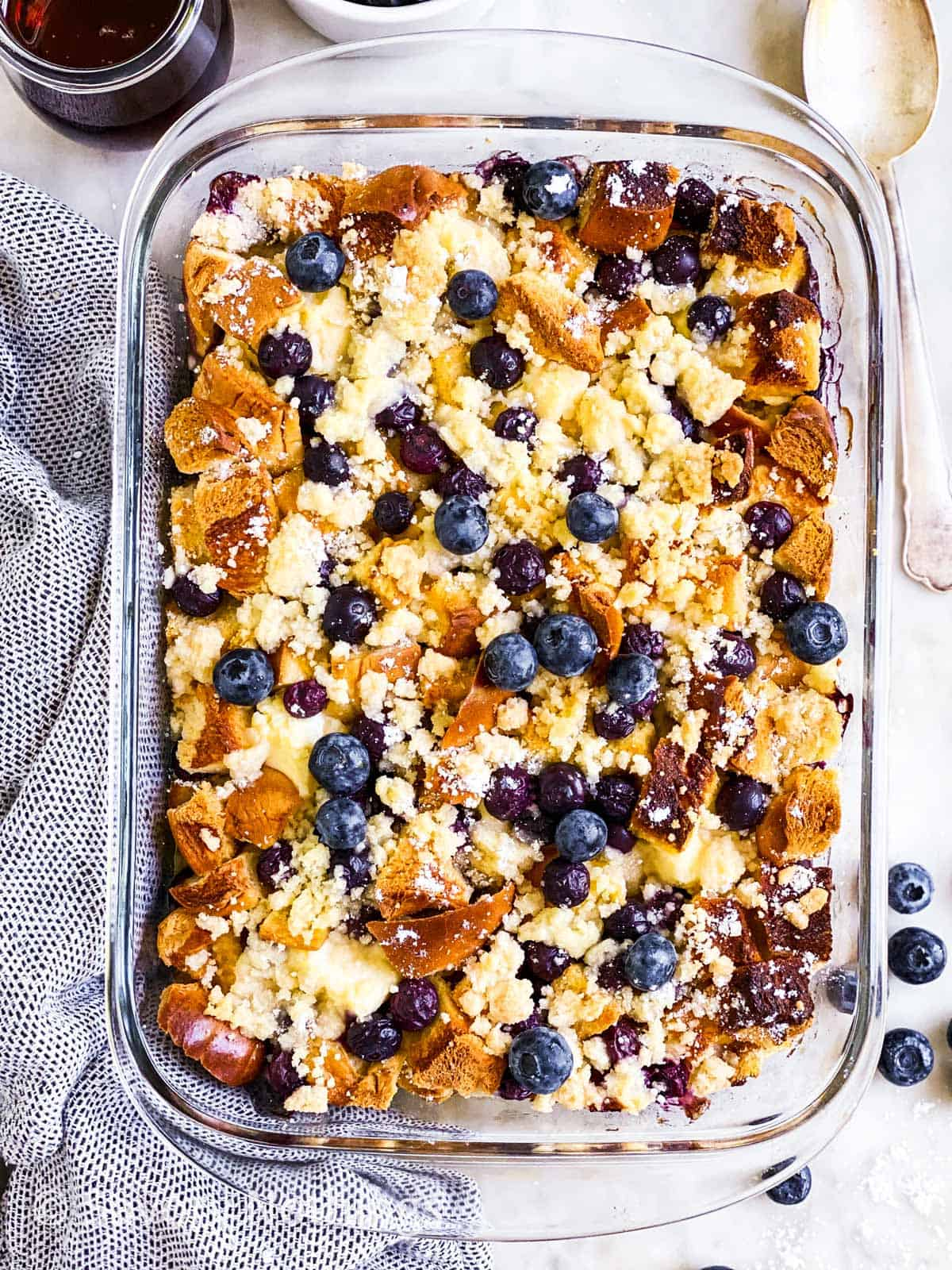 overhead view of blueberry French toast casserole in glass dish