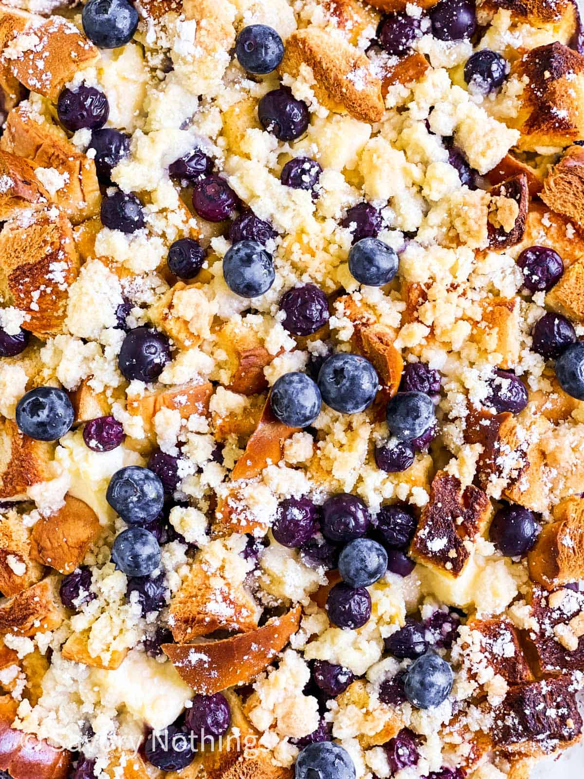 close up photo of baked blueberry French toast casserole with streusel topping