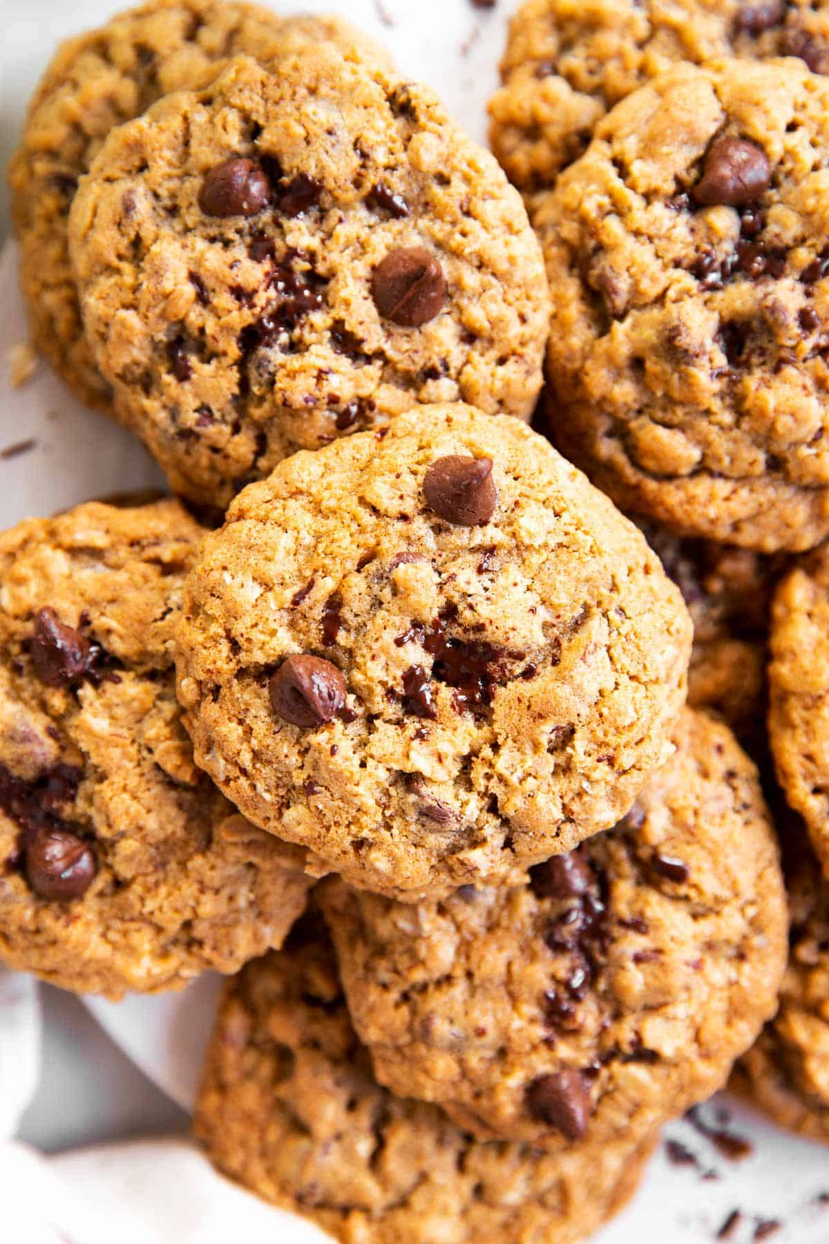 close up photo of oatmeal chocolate chip cookies in a pile