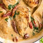 overhead close up view of creamy tuscan chicken in skillet