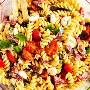 overhead view of Italian pasta salad in glass bowl