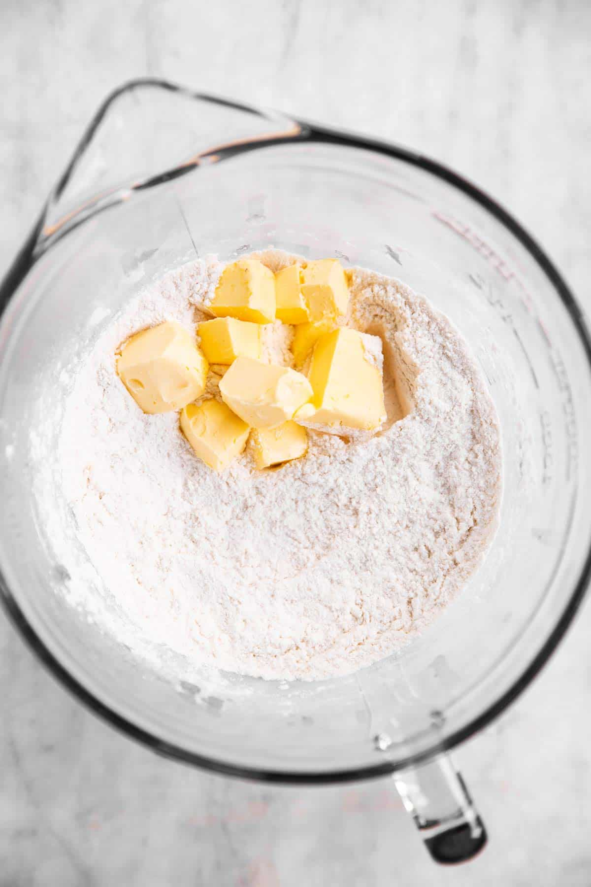 flour and butter in glass bowl