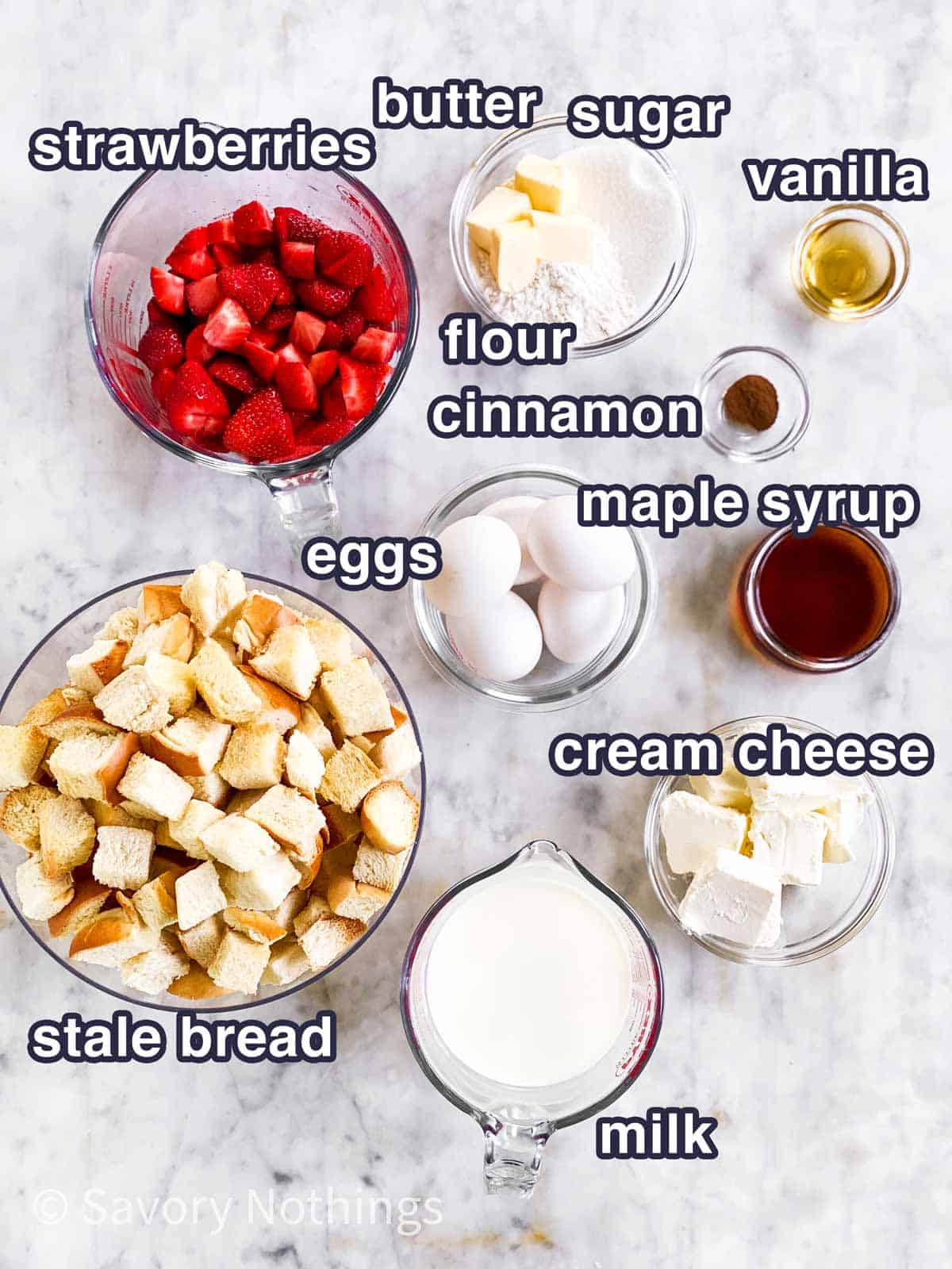 ingredients for strawberry French toast casserole with text labels