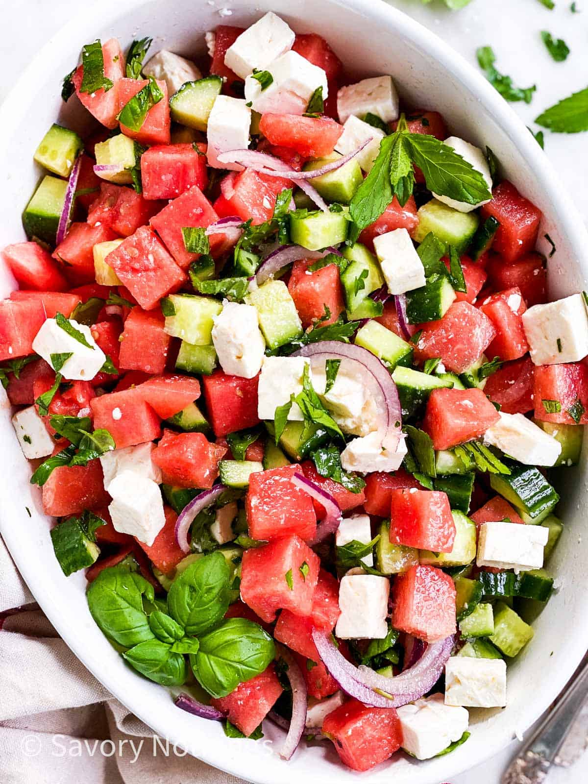 watermelon feta salad in shallow white dish