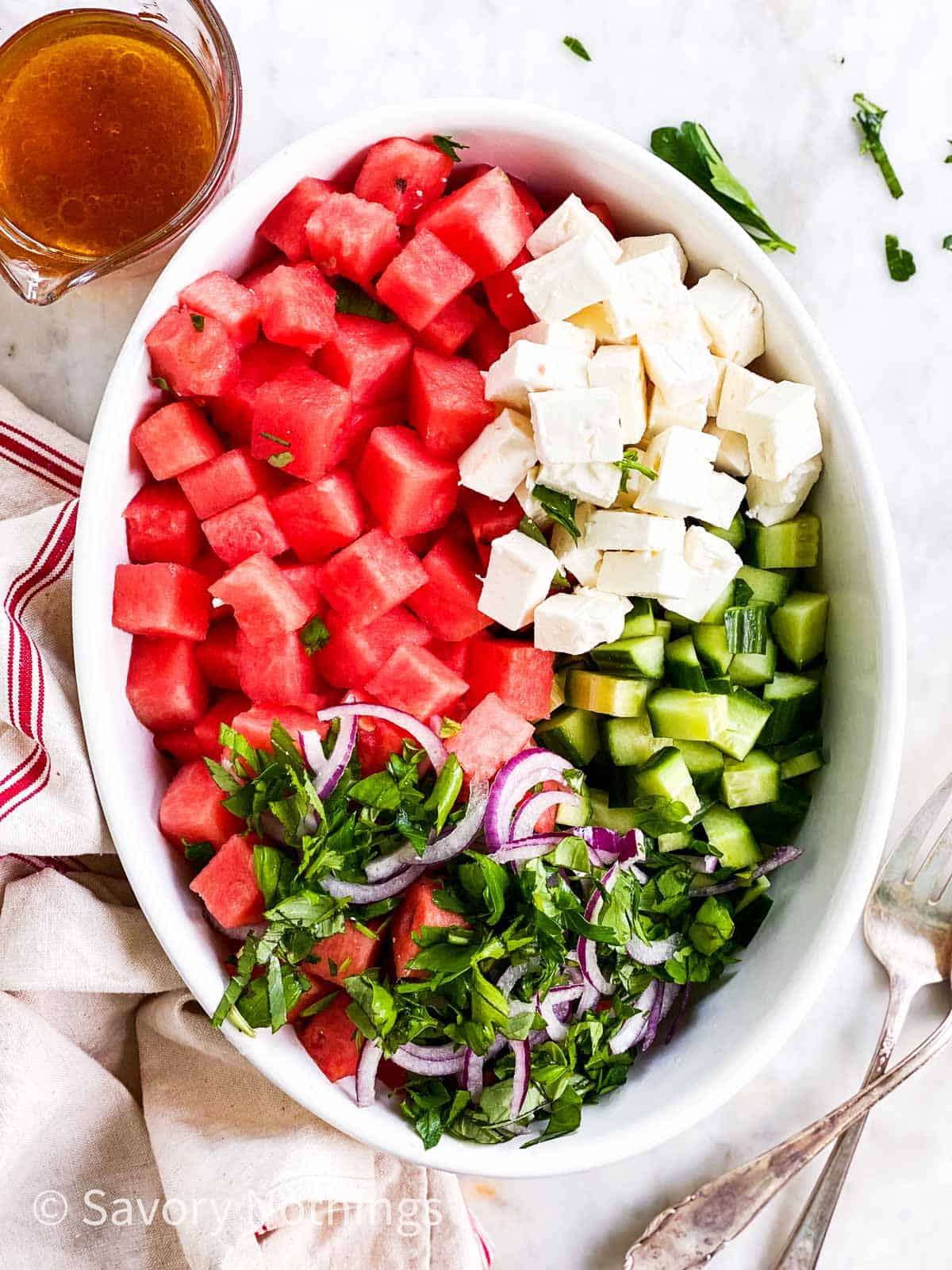 ingredients for watermelon salad in white oval dish