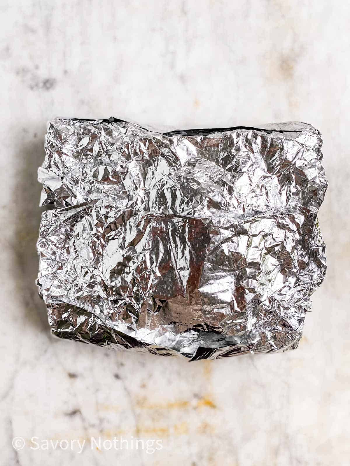 sealed foil pouch on marble surface