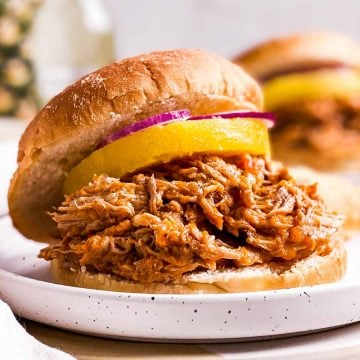 pineapple pulled pork on sandwich bun with canned pineapple ring