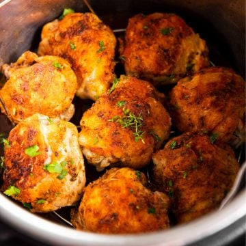 close up photo of eight cooked chicken thighs in instant pot