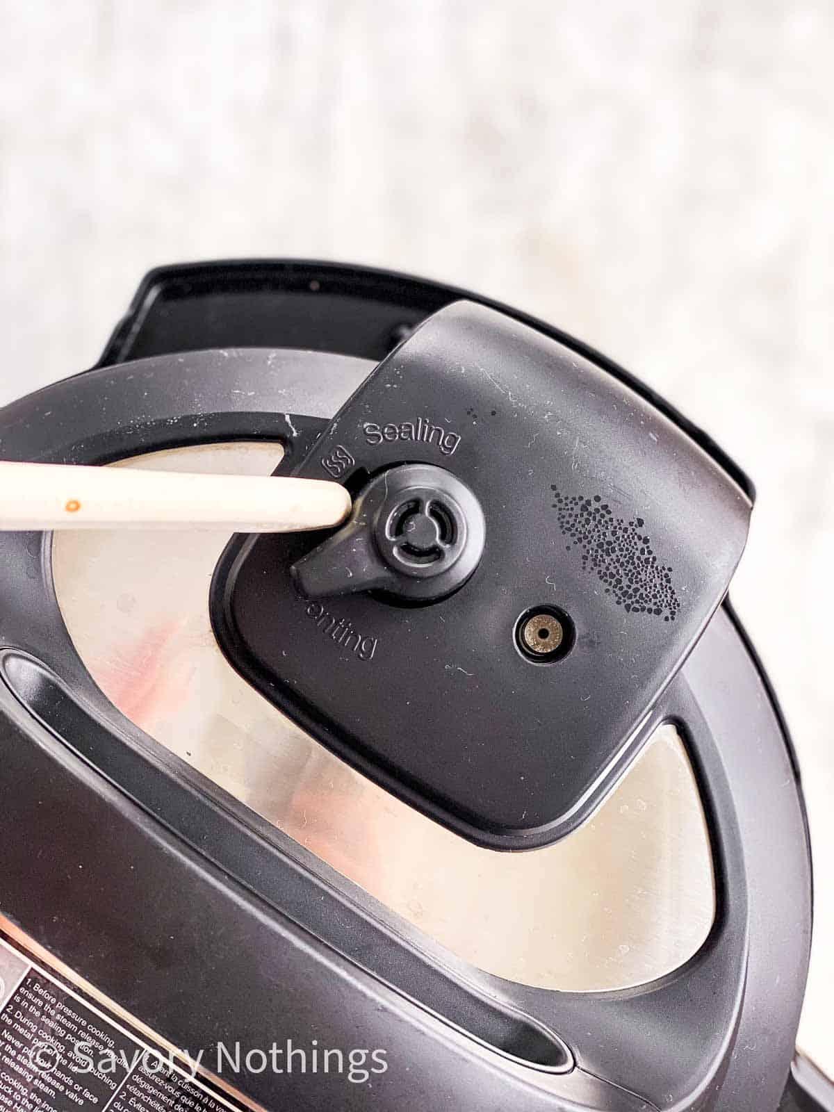 wooden stick moving valve on instant pot lid