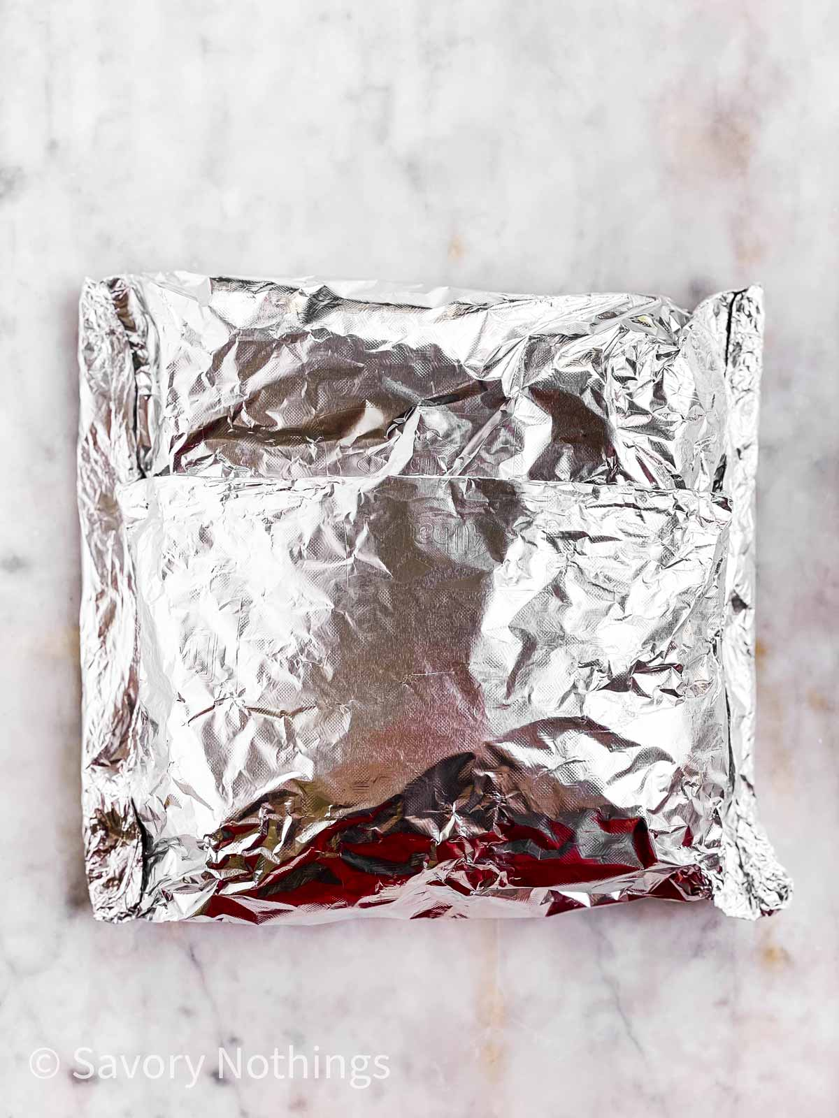 sealed foil packet on light marble surface