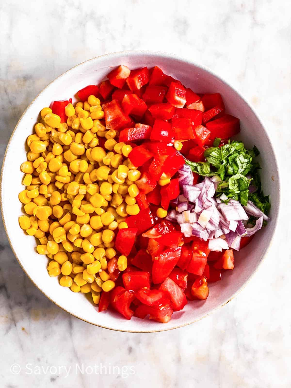 ingredients for summer corn salad in white bowl