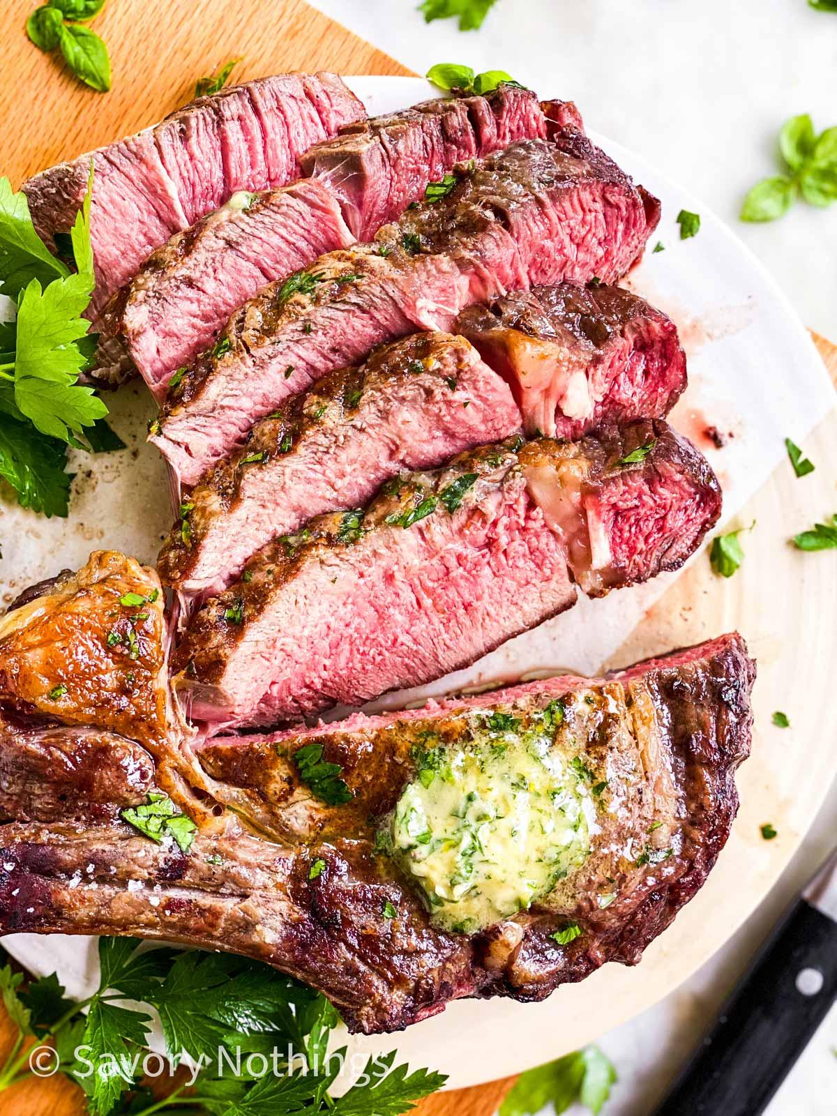 close up photo of sliced tomahawk steak